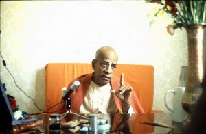 Srila-Prabhupada-preaching-with-finger-pointing-up